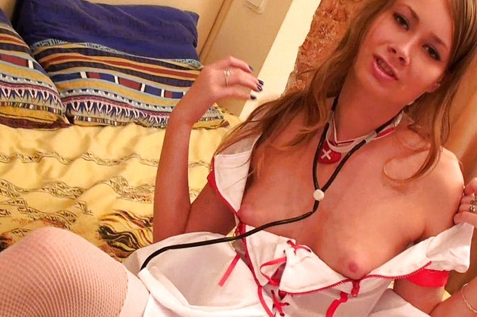 Milenna Plays With Her Self In A Nurse Outfit And Strips